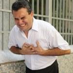 Man having a heart attack bending — Stock Photo