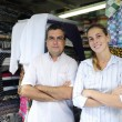 Family business partners owners of a fabric store — Stock Photo