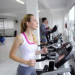 Running on treadmill at the gym — Stok fotoğraf