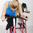 Spinning. Woman cycling indoors at the gym — Stock Photo