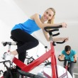 Spinning. Woman cycling at the gym — Stock Photo