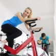 Stock Photo: Spinning. Woman cycling at the gym