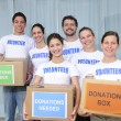 Volunteer group with food donation - Stock Photo