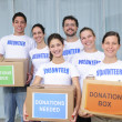 Stock Photo: Volunteer group with food donation