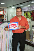 Retail business: store owner with open sign — Foto de Stock