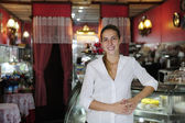 Small business: proud female owner of a cafe — Stock Photo