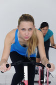 Women spinning at the gym — Stock Photo
