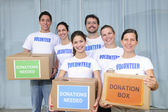 Volunteer group with food donation — Stock Photo