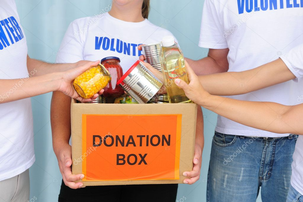 Volunteer putting food in a donation box — Foto de Stock   #10961857