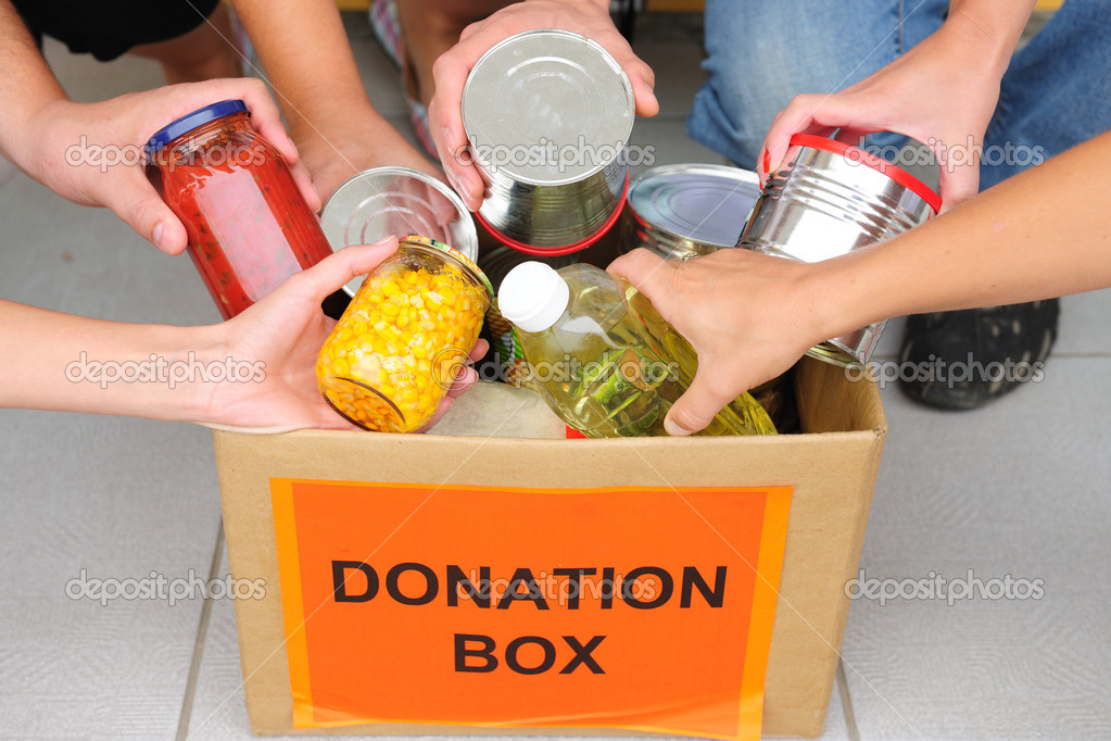 Volunteer putting food in a donation box — Stock Photo #10961867