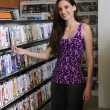 Teenage girl at the video rental store — Stock Photo #11217713
