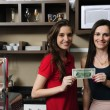 Stock Photo: Small business: Owners of a cafe holding cash