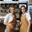 Waitresses working at a cafe — Stock Photo