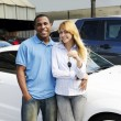Multiethnic couple buying a new car — Stock Photo #11217839