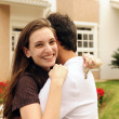 couple standing outside new house — Stock Photo