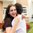 Couple standing outside new house — Stock Photo #11218208