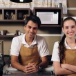Waitress and waiter working at a cafe — Stock Photo