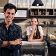 Stock Photo: Owner of cafe and waitress