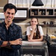 Owner of a cafe and waitress — Stock Photo