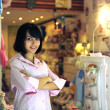 Small business owner: proud woman opening her baby store — 图库照片