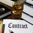 Contract and whiskey  on a desk — Stock Photo