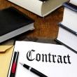 Contract with copy space on a desk - Stock Photo
