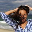 Stormy wind. wind blowing young woman's hair by the sea — Stock Photo #11219246