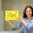 Happy owner of cafe showing open sign — Stock Photo #11219270