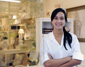 Small business owner: proud woman and her store — Stock Photo