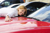 Woman loves her new sports car — Stock Photo