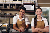 Waitress and waiter working at a cafe — Стоковое фото
