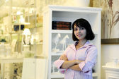 Small business owner: proud woman and her store — ストック写真