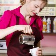 Friendly waitress making coffee — 图库照片