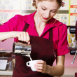 Friendly waitress making coffee — Stock Photo #10746386