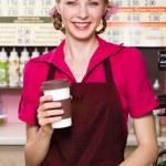 Friendly waitress making coffee — Stock Photo