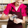 Friendly waitress making coffee — Stock Photo #10746405