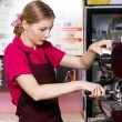 Friendly waitress making coffee - Stock Photo