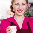 Friendly waitress making coffee — Stok fotoğraf
