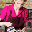Friendly waitress making coffee — Stock Photo #10746419