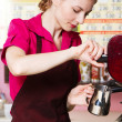 Friendly waitress making coffee — ストック写真