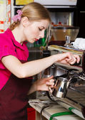 Friendly waitress making coffee — Stock Photo