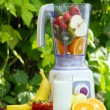 Stock Photo: Electric blender with fruits in it
