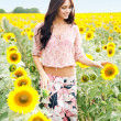 Beautiful lady in sunflower field — Stock Photo #11485082