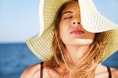 Beautiful woman on a beach — Stock Photo