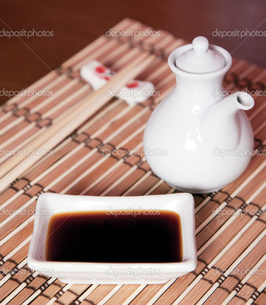 Soy sauce for sushi on a bamboo pad — Stock Photo #11485404