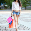 Beautiful woman with shopping bags — Lizenzfreies Foto