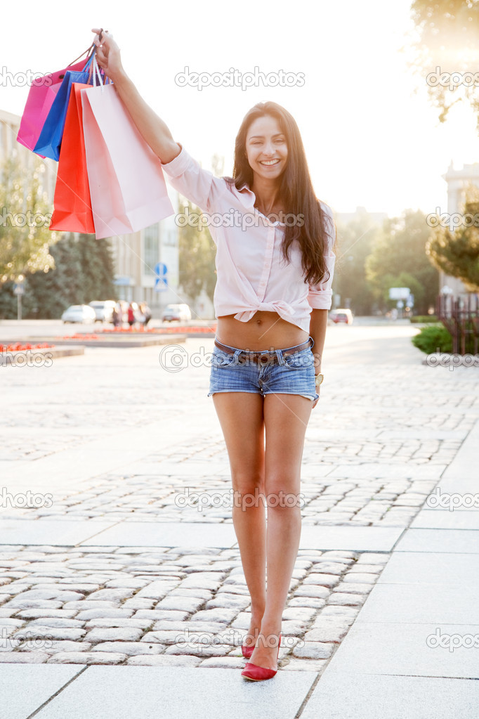 Street photo of beautiful woman with shopping bags  Stock Photo #11511702