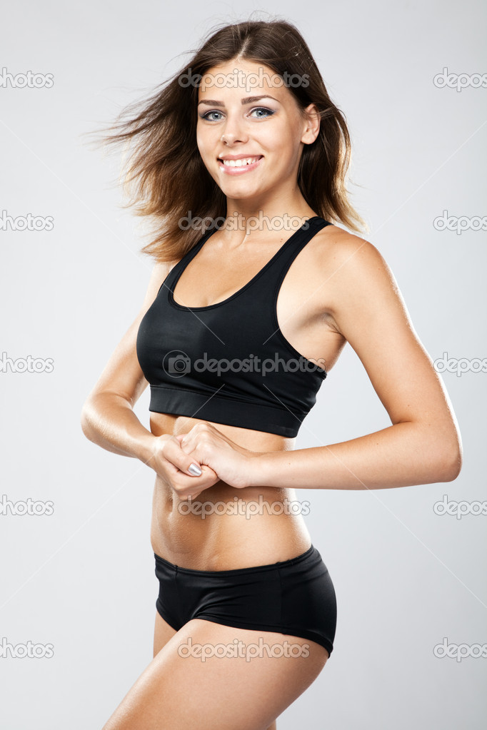 Young fit woman in sports outfit, studio photo — Stock Photo #11511827