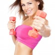 Beautiful slim woman with dumbbells — Stock Photo #11522785