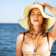 Beautiful woman on a beach — Stock Photo #11650591